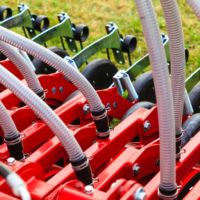 Agriculture equipment concept. Industrial detailed pneumatic, hydraulic machinery made of steel closeup