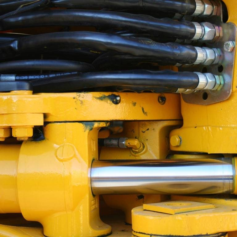 Hydraulic elements of the heavy building bulldozer of yellow color horizontally, (look similar images in my portfolio)